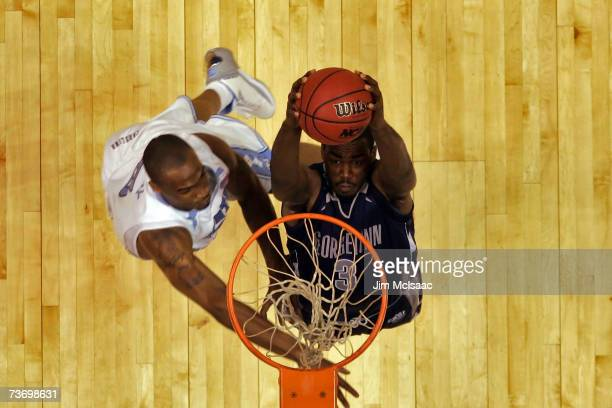 DaJuan Summers of the Georgetown Hoyas goes to the hoop against Reyshawn Terry of the University of North Carolina Tar Heels in the NCAA Men's East...