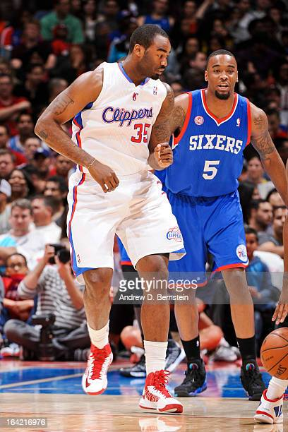 DaJuan Summers of the Los Angeles Clippers fights for position in his debut game for the team against Arnett Moultrie of the Philadelphia 76ers at...
