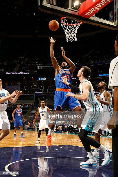 DaJuan Summers of the New York Knicks shoots against the Charlotte Hornets at the Time Warner Cable Arena on October 17 2015 in Charlotte North...