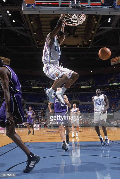 Dajuan Wagner of the Cleveland Cavaliers hangs from the rim after dunking during the game against the Sacramento Kings on November 26 2002 at Gund...