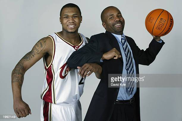 DaJuan Wagner of the Cleveland Cavaliers poses with Assistant Director of Player Relations Earl Patton Jr during the introduction of the new...