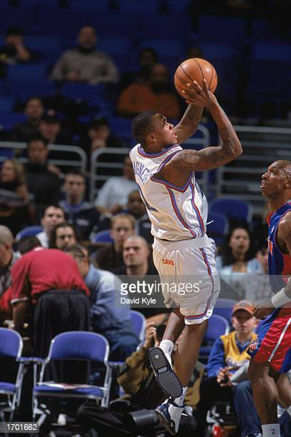 Dajuan Wagner of the Cleveland Cavaliers shoots over Chauncey Billups of the Detroit Pistons during the game at Gund Arena on December 18 2002 in...