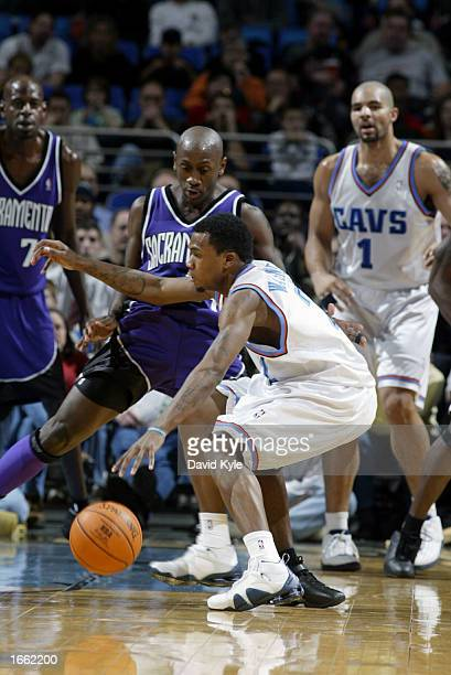 Dajuan Wagner of the Cleveland Cavaliers tries to get inside on Bobby Jackson of the Sacramento Kings at Gund Arena on November 26 2002 in Cleveland...