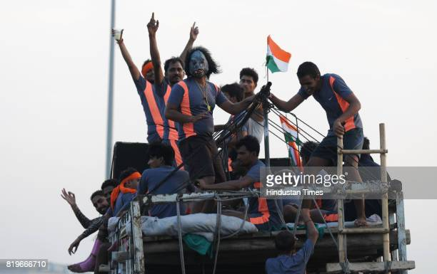 Dak Kanwarias carrying holy water from the Ganga on the eve of Shivaratri festival on July 20 2017 in Gurgaon India Every year lakhs of devotees of...