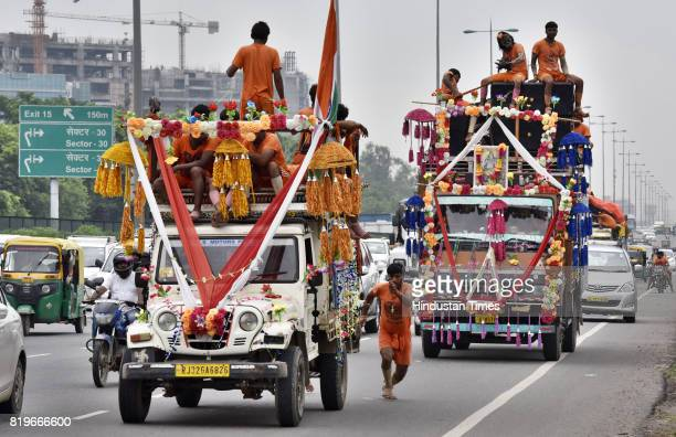 Dak Kanwarias on their journey to fetch the holy Ganga water to be offered on the idol of Lord Shiva on July 21 the day of Sawan Shivaratri on July...