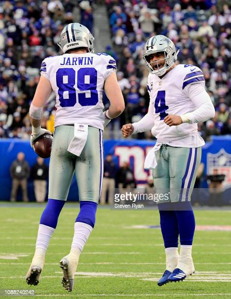 Dak Prescott and Blake Jarwin of the Dallas Cowboys celebrate their third quarter touchdown against the New York Giants at MetLife Stadium on...