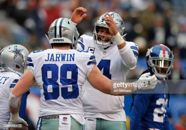 Dak Prescott and Blake Jarwin of the Dallas Cowboys in action against the New York Giants on December 30 2018 at MetLife Stadium in East Rutherford...