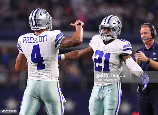 Dak Prescott and Ezekiel Elliott of the Dallas Cowboys celebrate after scoring a touchdown during the second quarter against the Tampa Bay Buccaneers...