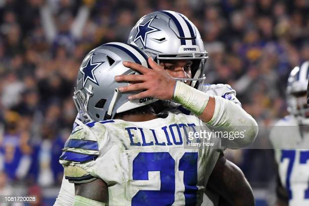 Dak Prescott and Ezekiel Elliott of the Dallas Cowboys react after a Prescott touchdown late in the fourth quarter against the Los Angeles Rams in...