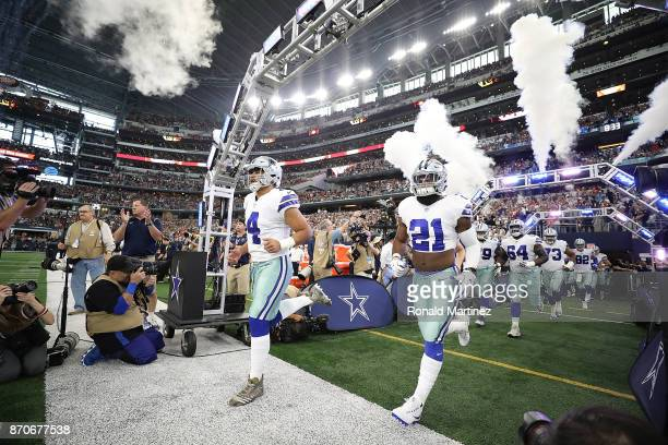 Dak Prescott and Ezekiel Elliott of the Dallas Cowboys runs onto the field before a game against the Kansas City Chiefs at ATT Stadium on November 5...