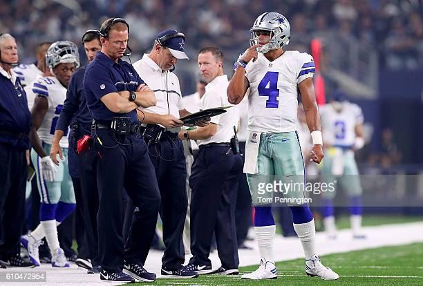 Dak Prescott and head coach of the Dallas Cowboys Jason Garrett look on during a game between the Dallas Cowboys and the Chicago Bears at ATT Stadium...