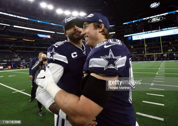 Dak Prescott and Sean Lee of the Dallas Cowboys celebrate a 44-21 win against the Los Angeles Rams at AT&T Stadium on December 15, 2019 in Arlington,...