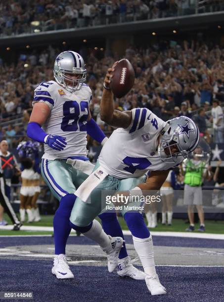 Dak Prescott celebrates his touchdown run with Jason Witten of the Dallas Cowboys in the fourth quarter against the Green Bay Packers at ATT Stadium...