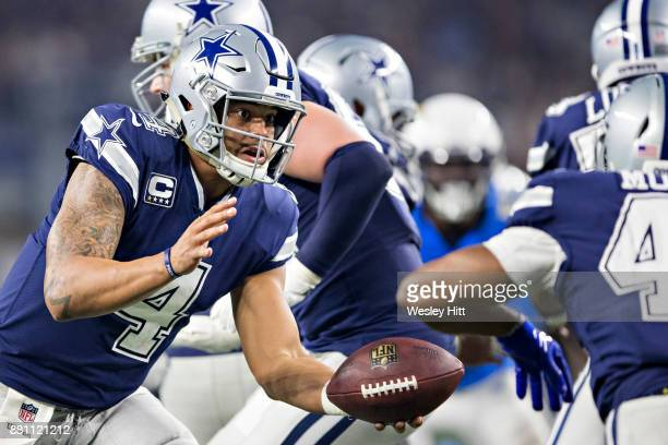 Dak Prescott hands off the ball to Alfred Morris of the Dallas Cowboys during a game against the Los Angeles Chargers at ATT Stadium on November 23...