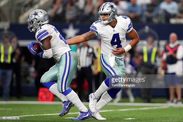 Dak Prescott hands off to Ezekiel Elliott of the Dallas Cowboys during the second half against the Baltimore Ravens at ATT Stadium on November 20...