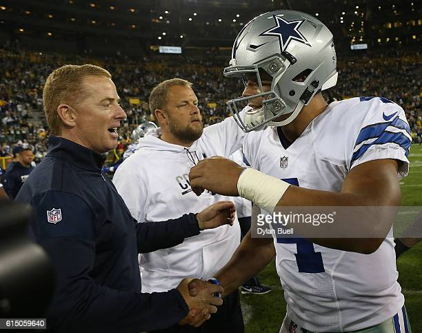 Dak Prescott is congratulated by his head coach Jason Garrett of the Dallas Cowboys after defeating the Green Bay Packers at Lambeau Field on October...
