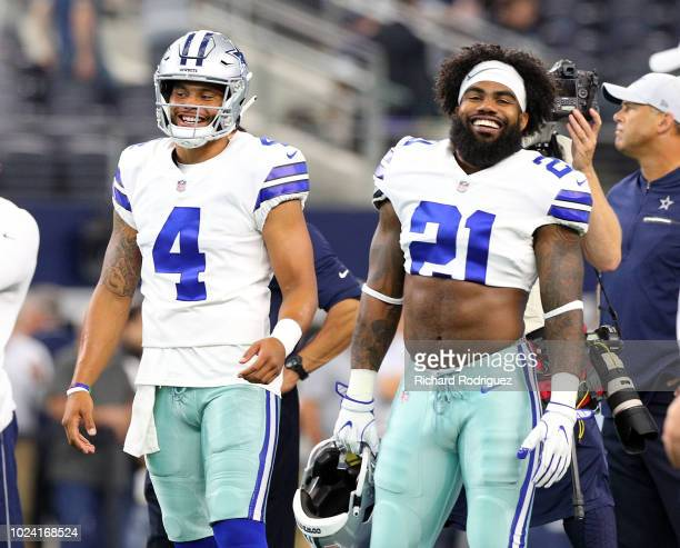Dak Prescott of the Dallas Cowboys and Ezekiel Elliott of the Dallas Cowboys smile during warm ups before the preseason game against the Arizona...