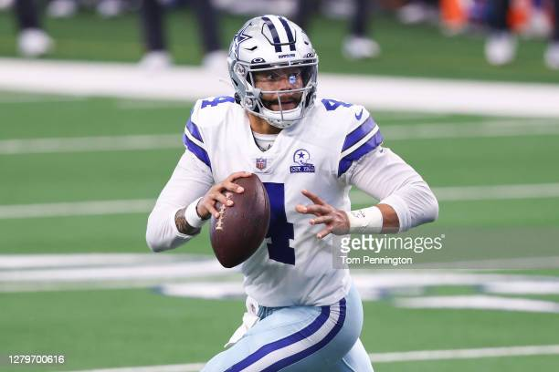 Dak Prescott of the Dallas Cowboys attempts a pass against the New York Giants during the second quarter at AT&T Stadium on October 11, 2020 in...