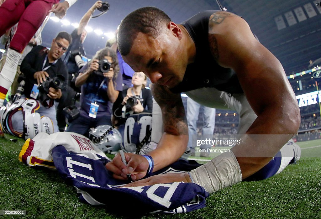 Dak Prescott #4 of the Dallas Cowboys autographs his jersey for DeSean Jackson #11 of the Washington Redskins after the Dallas Cowboys beat the Washington Redskins 31-26 at AT&T Stadium on November 24, 2016 in Arlington, Texas.