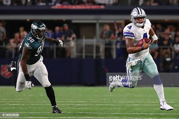 Dak Prescott of the Dallas Cowboys avoids the tackle of Marcus Smith of the Philadelphia Eagles in the fourth quarter during a game between the...