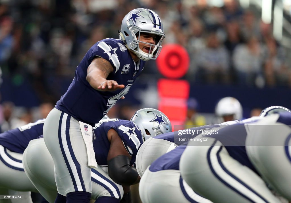Dak Prescott #4 of the Dallas Cowboys calls a play on the line in the first half of a football game at AT&T Stadium on November 23, 2017 in Arlington, Texas.