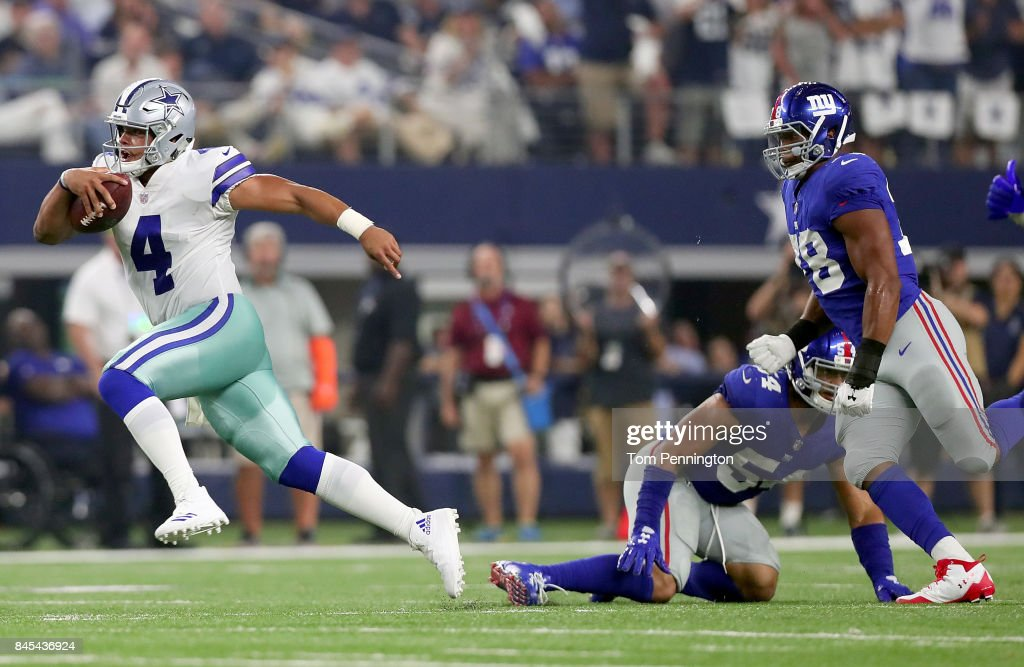 Dak Prescott #4 of the Dallas Cowboys carries the ball against Olivier Vernon #54 of the New York Giants in the second quarter at AT&T Stadium on September 10, 2017 in Arlington, Texas.