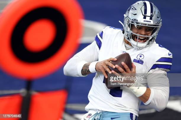 Dak Prescott of the Dallas Cowboys catches a touchdown pass against the New York Giants during the second quarter at AT&T Stadium on October 11, 2020...