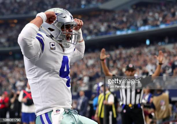 Dak Prescott of the Dallas Cowboys celebrates a touchdown in the first quarter of a football game against the Tampa Bay Buccaneers at AT&T Stadium on...