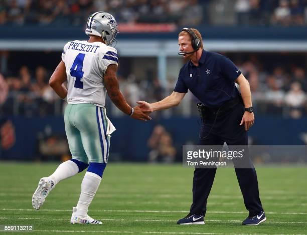 Dak Prescott of the Dallas Cowboys celebrates a touchdown with head coach Jason Garrett of the Dallas Cowboys in the second quarter of a football...