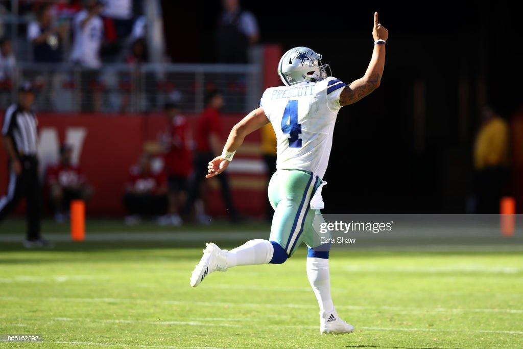 Dak Prescott #4 of the Dallas Cowboys celebrates after a 72-yard touchdown run by Ezekiel Elliott #21 against the San Francisco 49ers during their NFL game at Levi's Stadium on October 22, 2017 in Santa Clara, California.