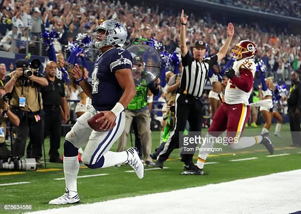 Dak Prescott of the Dallas Cowboys celebrates after scoring a touchdown during the fourth quarter against the Washington Redskins at ATT Stadium on...