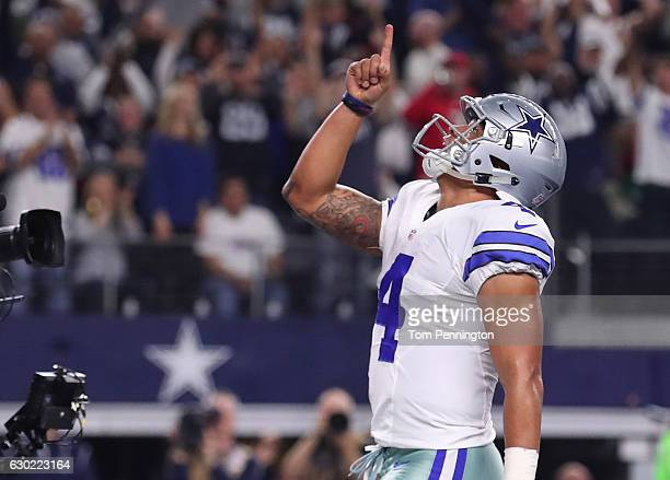 Dak Prescott of the Dallas Cowboys celebrates after scoring a touchdown during the second quarter against the Tampa Bay Buccaneers at ATT Stadium on...