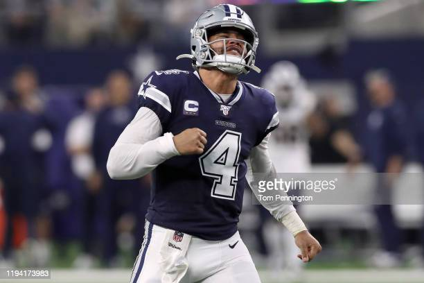 Dak Prescott of the Dallas Cowboys celebrates after the Dallas Cowboys score a touchdown against the Los Angeles Rams in the second quarter at ATT...
