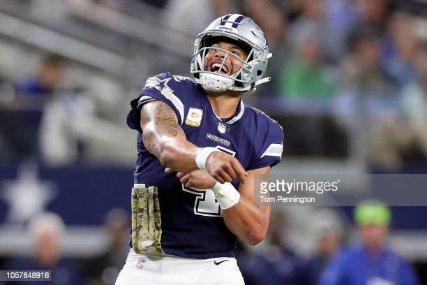 Dak Prescott of the Dallas Cowboys celebrates after throwing a touchdown pass to Allen Hurns of the Dallas Cowboys against the Tennessee Titans in...