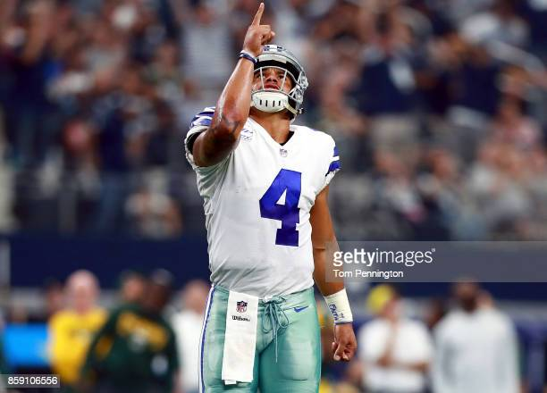Dak Prescott of the Dallas Cowboys celebrates after throwing a touchdown pass to Dez Bryant of the Dallas Cowboys to score against the Green Bay...