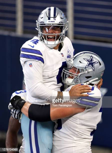 Dak Prescott of the Dallas Cowboys celebrates his touchdown reception against the New York Giants during the second quarter at AT&T Stadium on...
