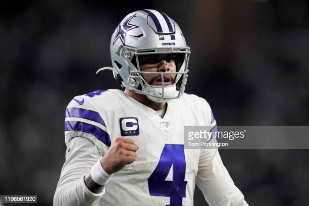 Dak Prescott of the Dallas Cowboys celebrates in the third quarter against the Washington Redskins in the game at AT&T Stadium on December 29, 2019...