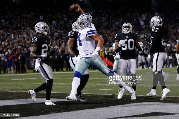 Dak Prescott of the Dallas Cowboys celebrates scoring on a fiveyard run against the Oakland Raiders during their NFL game at OaklandAlameda County...