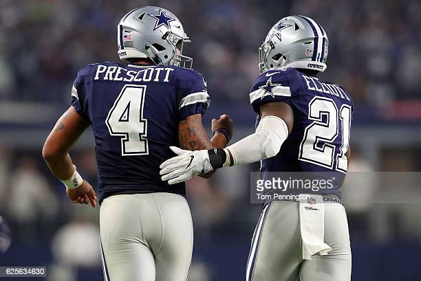 Dak Prescott of the Dallas Cowboys celebrates with Ezekiel Elliott after scoring a touchdown during the fourth quarter against the Washington...