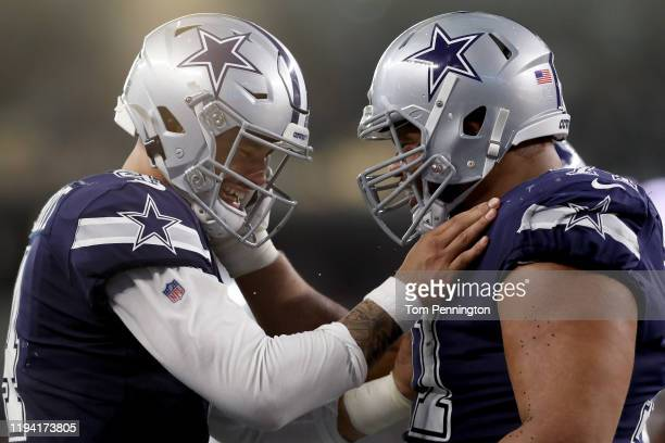 Dak Prescott of the Dallas Cowboys celebrates with La'el Collins of the Dallas Cowboys after the Dallas Cowboys scored a touchdown against the Los...