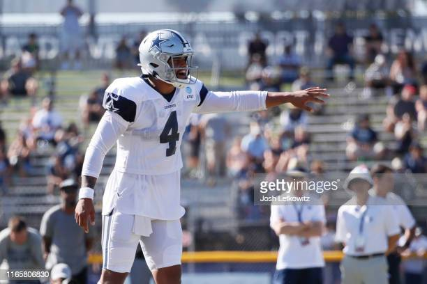 Dak Prescott of the Dallas Cowboys communicates with his teammates during training camp on August 2, 2019 in Oxnard, California.