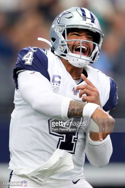 Dak Prescott of the Dallas Cowboys completes a pass against the Miami Dolphins in the third quarter at ATT Stadium on September 22 2019 in Arlington...