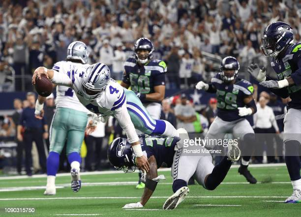 Dak Prescott of the Dallas Cowboys dives but falls short of the end zone against the Seattle Seahawks in the fourth quarter during the Wild Card...