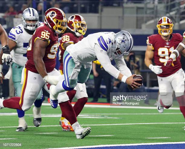 Dak Prescott of the Dallas Cowboys dives into the end zone for a touchdown in the fourth quarter against the Washington Redskins at ATT Stadium on...