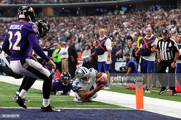 Dak Prescott of the Dallas Cowboys dives toward the end zone with the ball during the second quarter against the Baltimore Ravens at ATT Stadium on...
