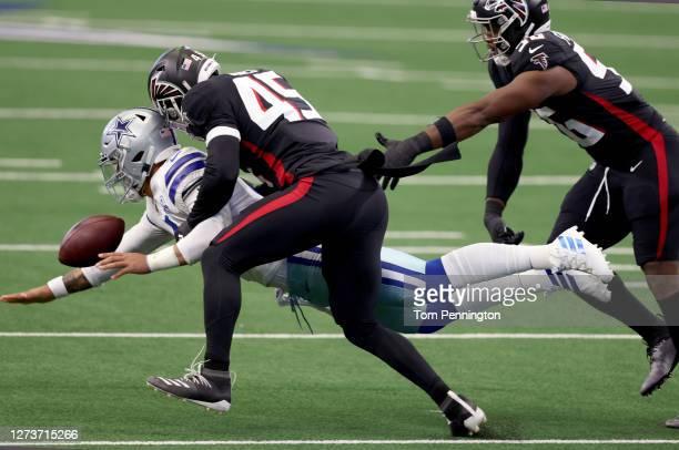 Dak Prescott of the Dallas Cowboys fumbles the ball after being hit by Deion Jones of the Atlanta Falcons and Dante Fowler Jr. #56 of the Atlanta...
