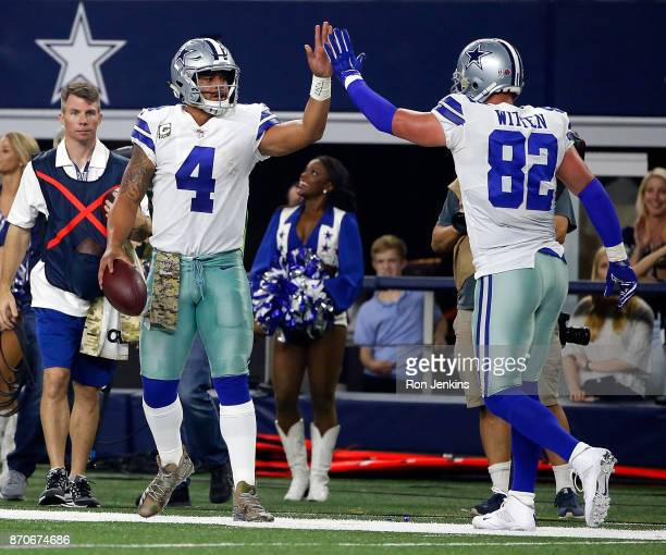 Dak Prescott of the Dallas Cowboys gets a high five from Terrance Williams of the Dallas Cowboys after scrabling for a first down in the second half...