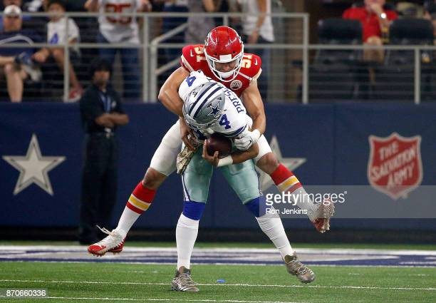 Dak Prescott of the Dallas Cowboys gets sacked by Frank Zombo of the Kansas City Chiefs in the second half of a football game at ATT Stadium on...