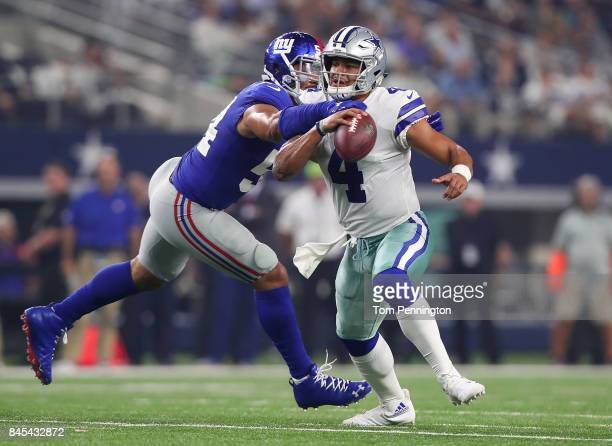 Dak Prescott of the Dallas Cowboys gets sacked by Olivier Vernon of the New York Giants in the second quarter of a game at ATT Stadium on September...