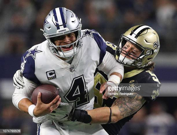 Dak Prescott of the Dallas Cowboys gets sakced by Craig Robertson of the New Orleans Saints in the second half of a game at ATT Stadium on November...